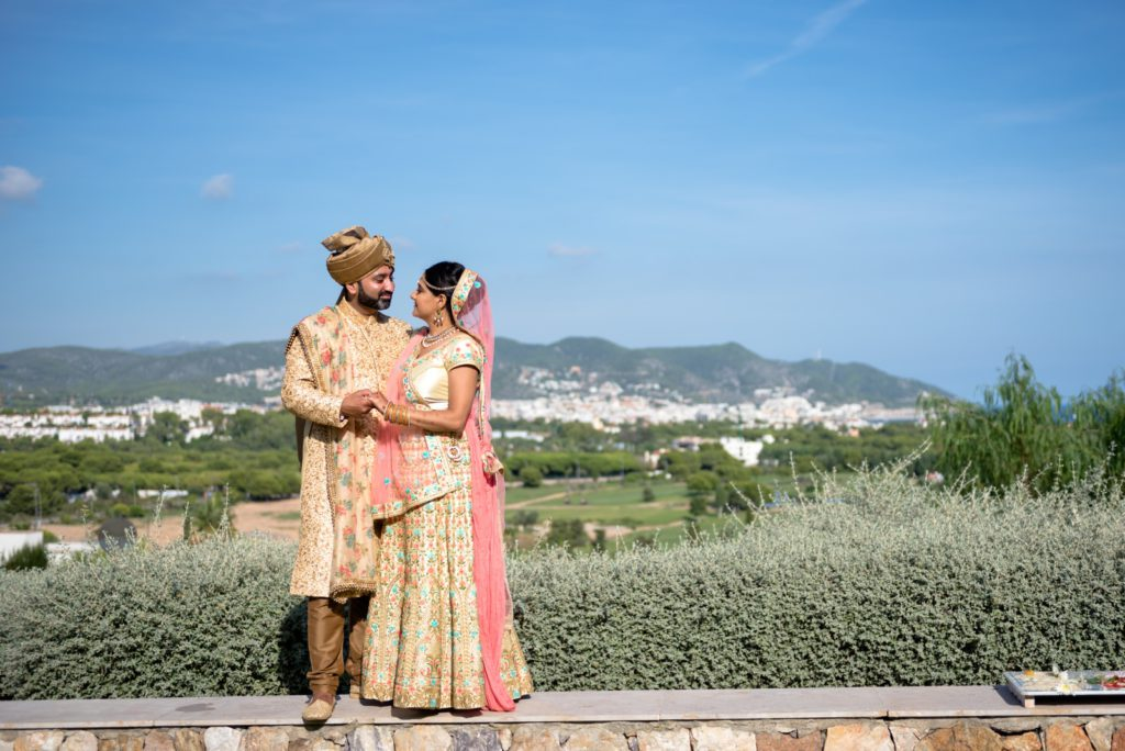 Matching turban on the groom's head embellished with pearls and other precious stones.
